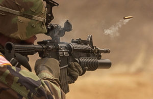 Photo of American soldier firing AR15